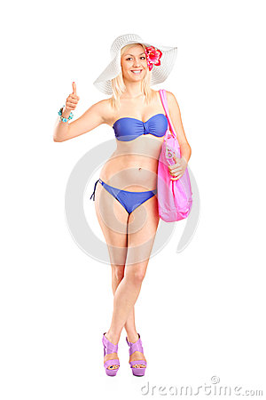 Blond woman in swimsuit giving a thumb up