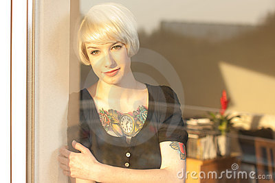 Blond woman with tattoo