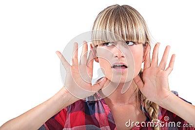 Woman touching ears