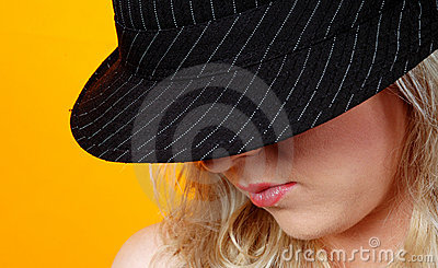 Blond woman with trendy hat