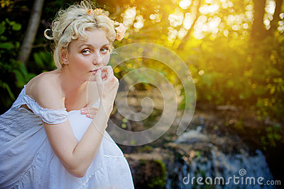 Blond woman wearing white dress