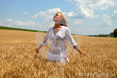 Blond woman in wheat field
