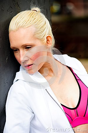 Blond womanwearing white tracksuit