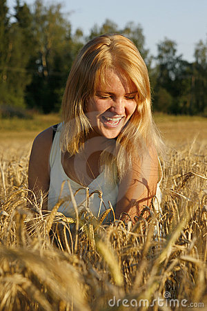 Blond young woman laughing from heart