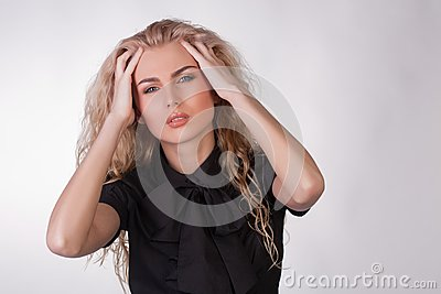 Blond young woman with a pounding headache