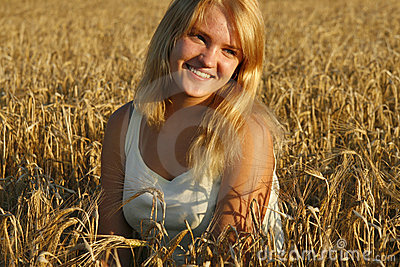 Blond young woman smiling sweetly.