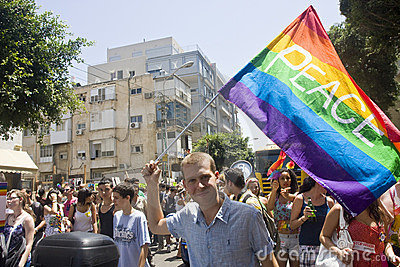 Blond youth with peace flag at Pride Parade TA Editorial Stock Photo