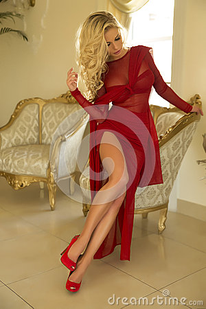 Free Blonde Beautiful Woman Posing In Red Dress. Royalty Free Stock Photos - 36161458
