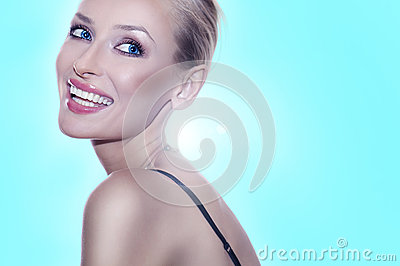 Blonde beauty posing with toothy smile.