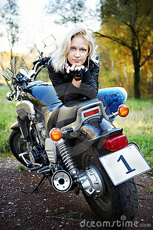 The blonde and big motorcycle