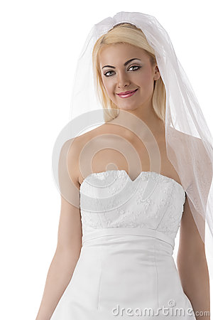 Blonde bride with veil smiles