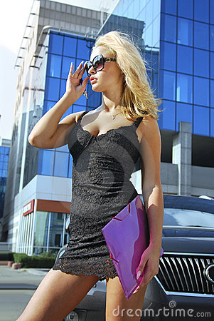 Blonde businesswoman with pink folder.