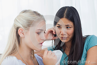 Blonde crying and talking as her friend is listening