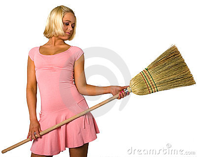 Blonde in dress and broom