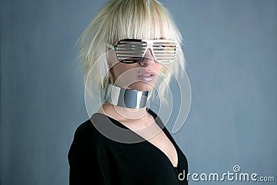 Blonde fashion futuristic silver glasses girl