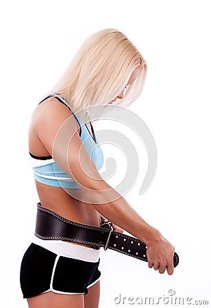 Blonde fastening her belt