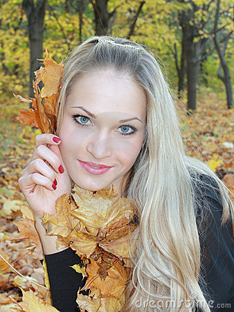 Blonde in forest with yellow sheets