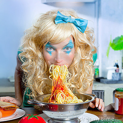 Blonde funny on kitchen eating pasta like crazy
