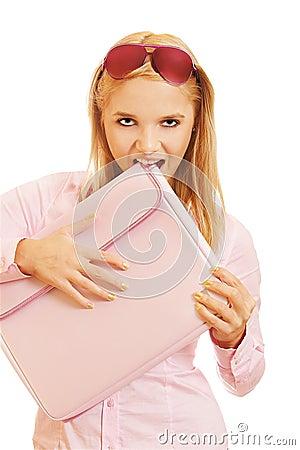 Blonde girl biting folder