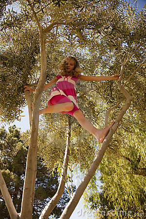 Blonde Girl Climbing High in a Tree
