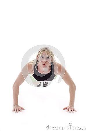 Blonde girl doing push ups