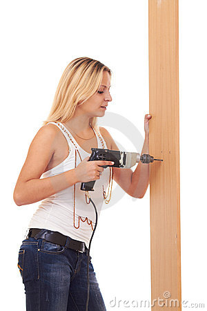 Blonde girl drilling the wall