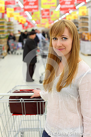 Blonde girl with empty cart