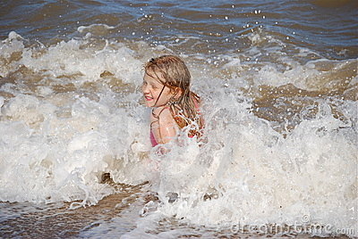 Blonde girl enjoying the waves