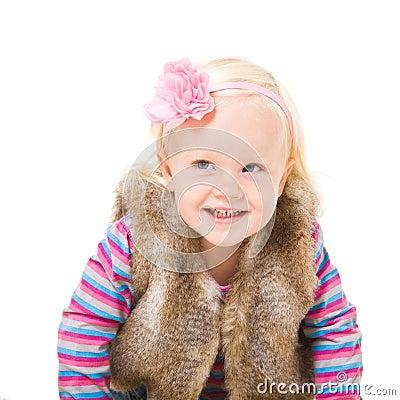 blonde girl in a fur vest