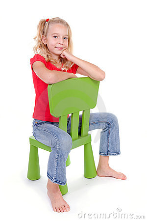 Blonde girl on green chair