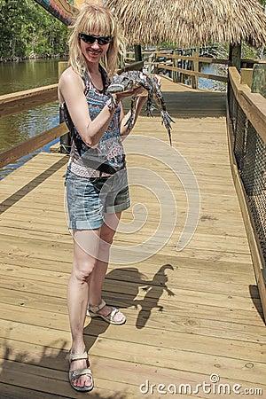 blonde girl with alligator