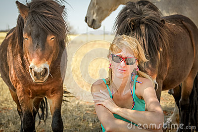 girl and the horses of the desert