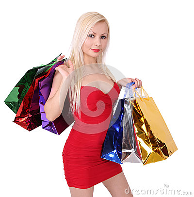 Free Blonde Girl In Red Dress With Shopping Bags Royalty Free Stock Photography - 27782817