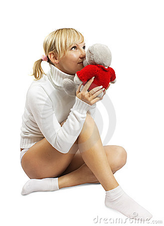 Blonde girl incumbent with cuddly toy