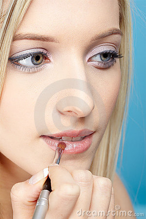 Blonde girl making up