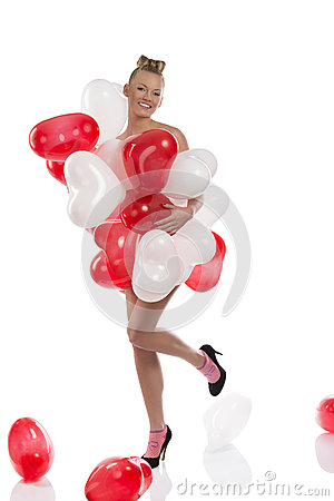Blonde girl with many balloons on her body