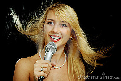 Blonde girl with naked shoulders singing karaoke