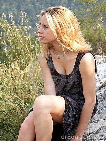 Blonde girl outdoors