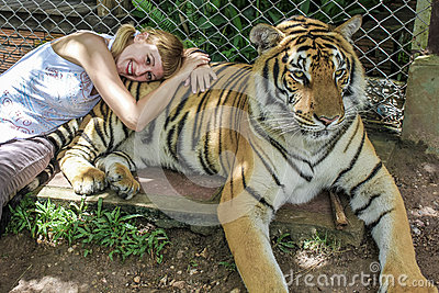 blonde girl and tiger