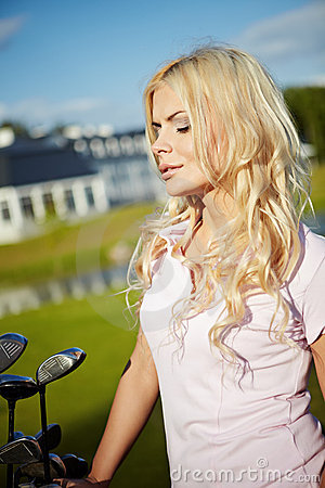 Blonde girl play golf