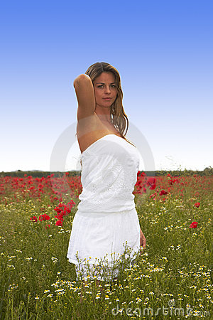 Blonde Girl in the Poppies Field