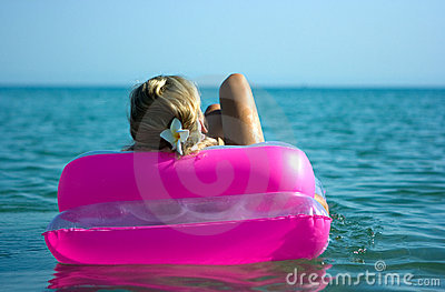 Blonde girl on raft