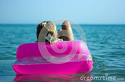 Blonde girl on raft
