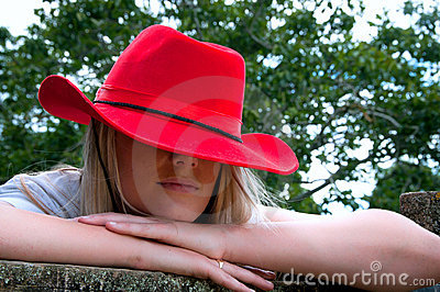 Blonde girl in red stetson hat