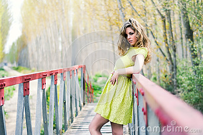 Blonde girl in a rural bridge