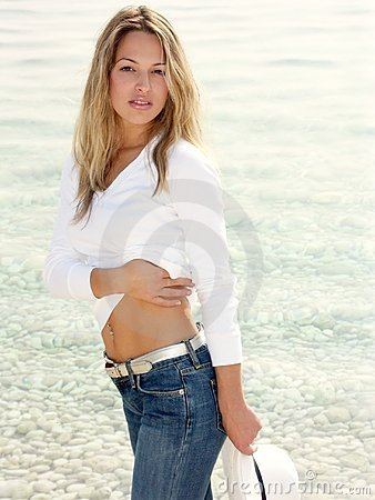Free Blonde Girl Standing By The Sea Stock Photos - 70053