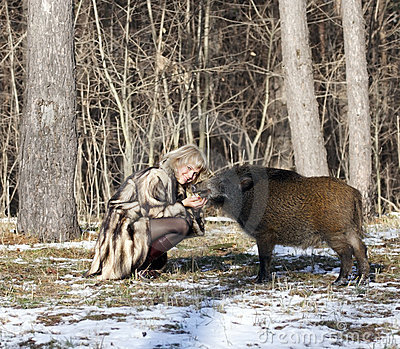 Blonde girl with wild boar