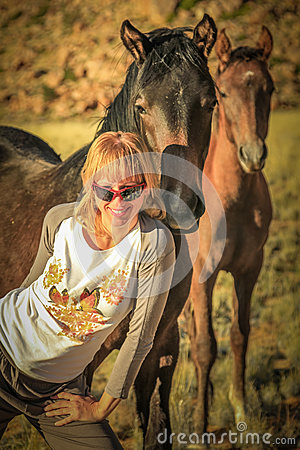 Woman and wild horses