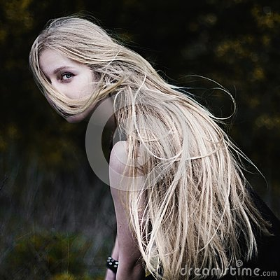 Free Blonde Girl With Very Long Hair On Dark Royalty Free Stock Image - 106185756