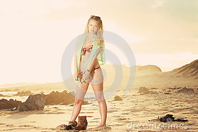 Blonde with golden setting set lighting her up fm behind